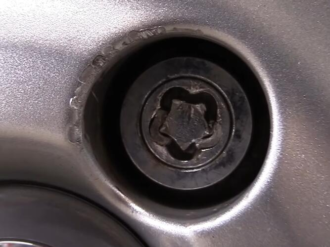 How-to-Remove-the-Locking-Lug-Nuts-without-Key-for-2008-Volvo-XC70-1